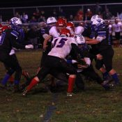 Titans topple Pioneers to keep playoff hopes alive
